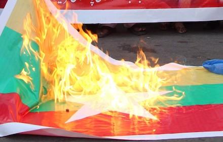 Burning Myanmar flag
