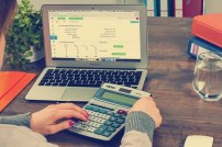 calculating finance using laptop and calculator