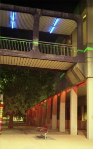 The red and blue lights are quite prominent in their coloration, however, they struggled to fill their structures with coloured light, overwhelmed by the white street lights. In this shot a green laser light streaks across the footbridge.