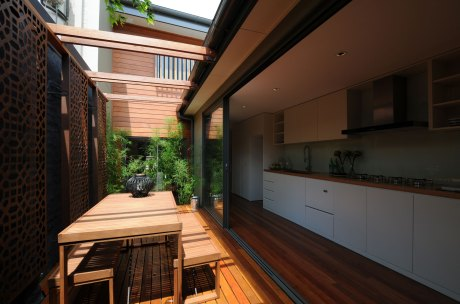 The courtyard is located to the immediate rear of the main body of the terrace, with the kitchen opening to and extending the width of courtyard.