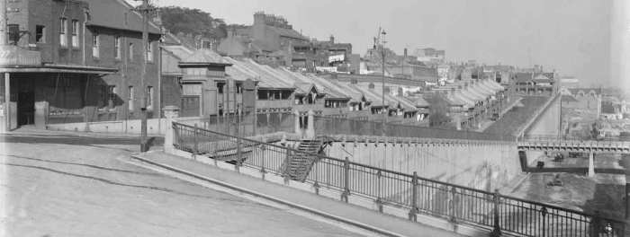 A view of part of the Urban Project for High Street Terrace and Wharf 4. High street visible with the bridge connecting High Street Terrace and an upper level roadway on Wharf 4 (not visible in this image), right of image.