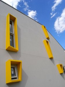 Warped yellow boxes surround the north western windows of the terraces to provide some protection from the afternoon sun.