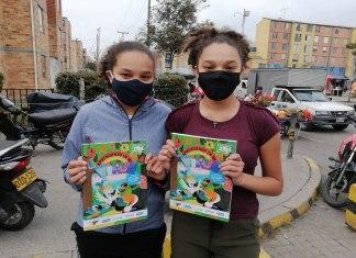 Girls with Zuri booklet from Plan International