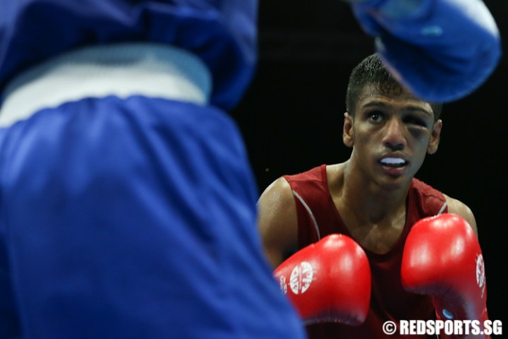 SEA Games Boxing  Flyweight   Mohamed Hanurdeen Hamid loses 1 2 to     Hanurdeen Hamid  Red  of Singapore lost 1   2 against Ian Clark Bautista