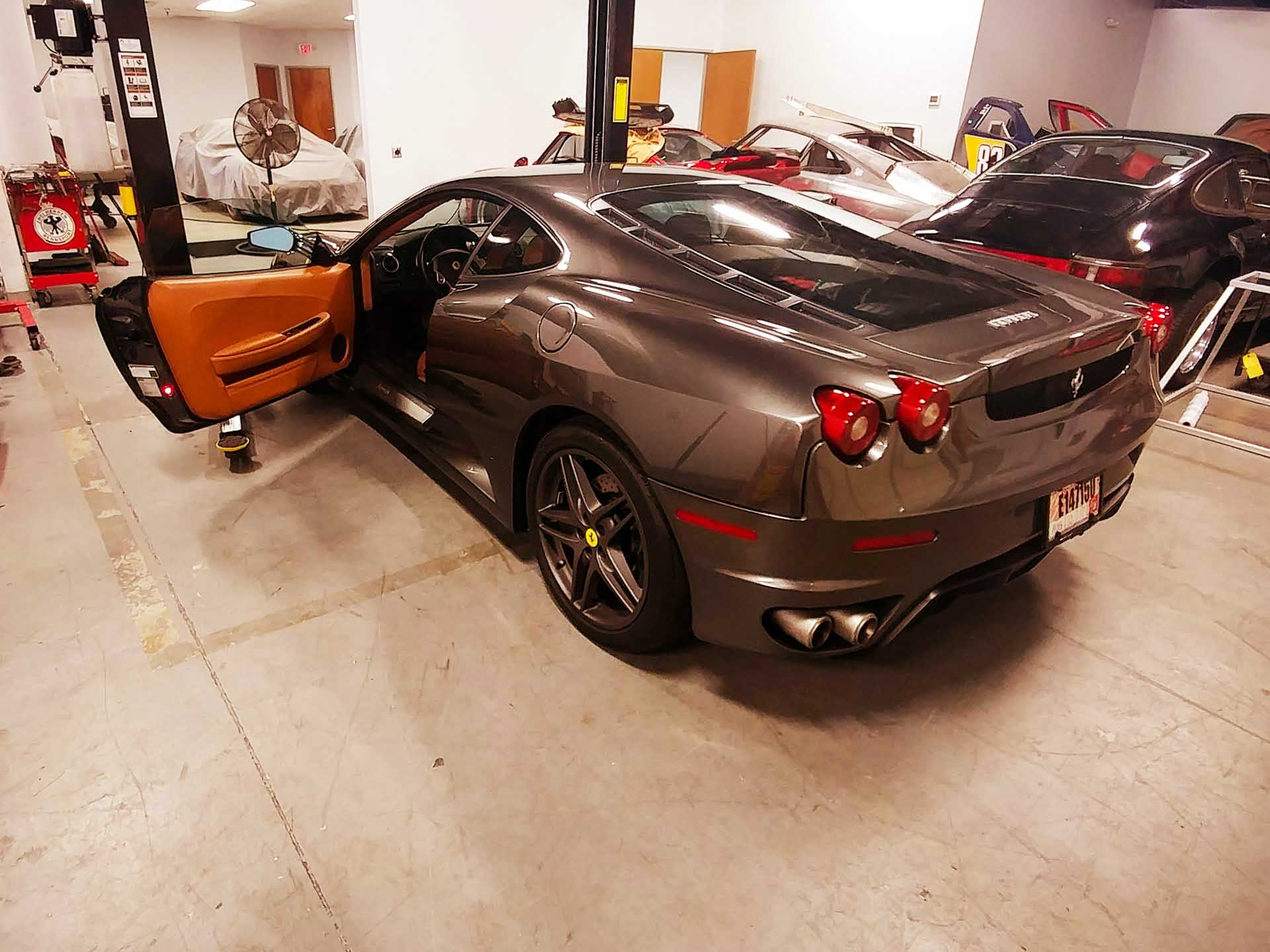 ferrari f430 being serviced in shop