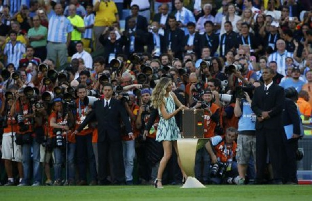 Supermodel Gisele Bundchen opens the box containing the 2014 World Cup trophy before the start of the final match between Germany and Argentina at the Maracana stadium in Rio de Janeiro