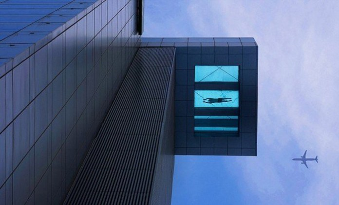 8.-Glass-bottom-swimming-poolon-the-24th-floor-630x382