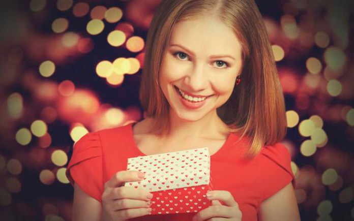 beauty pretty girl in red dress with gift box to Christmas or Valentine's Day