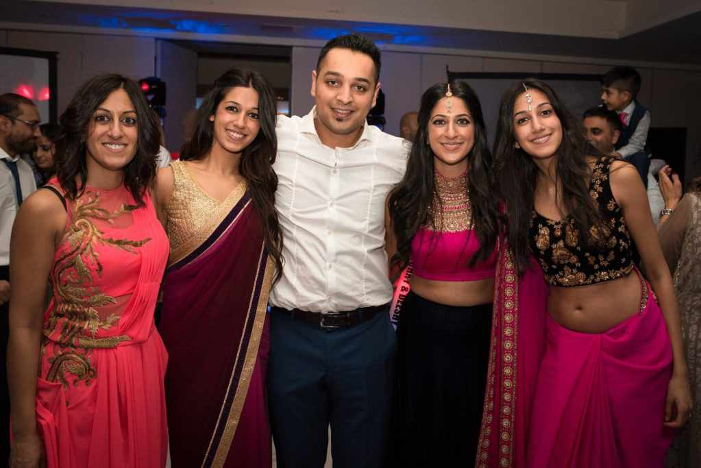Wedding photography indian family on dance floor
