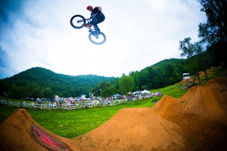 BMX Biker Over Dirt Jumps