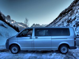 silver van on icy road in Chamonix valley