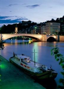 boat on rhone in Lyon by night
