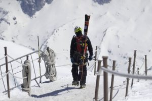 Alpinist going down the arete