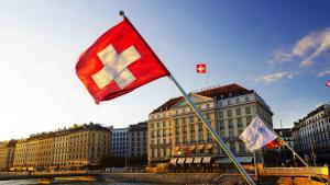 swiss flag by the river in Geneva