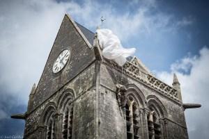 Church tower in Sainte-Mère-Église, Normandy, France