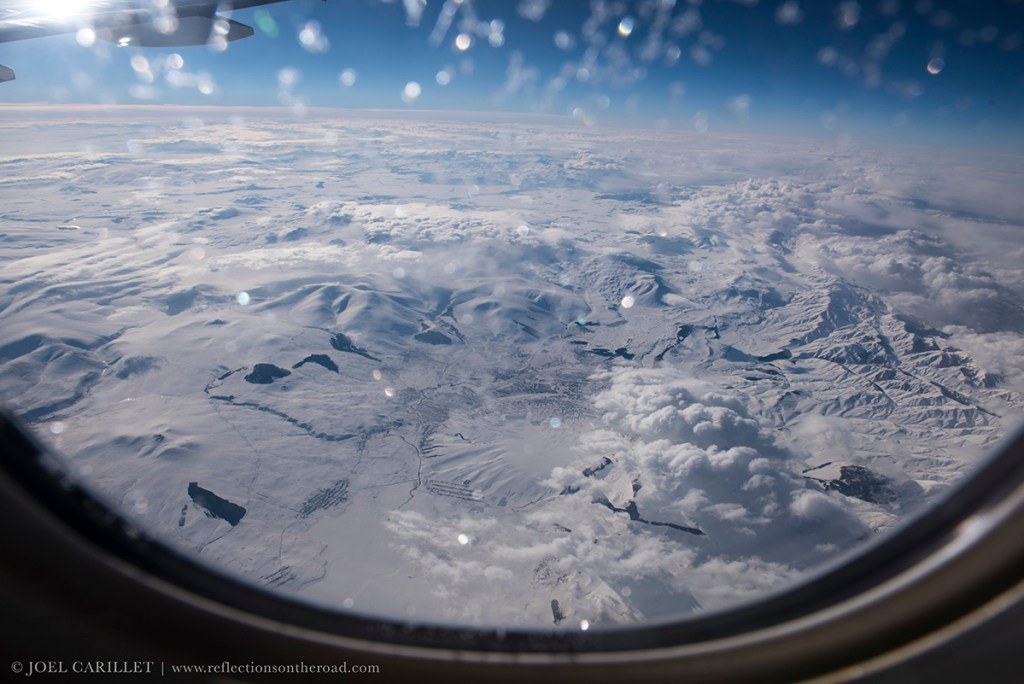 Caucasus viewed from airplane window in winter