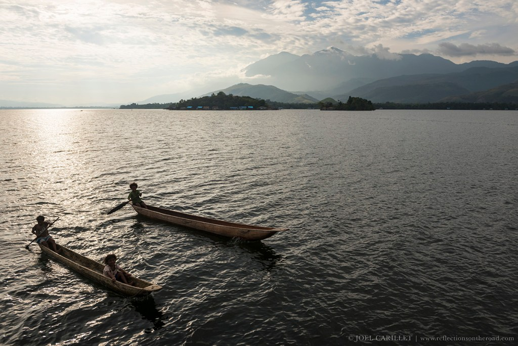 Canoes on Lake Sentani, Papua, Indonesia