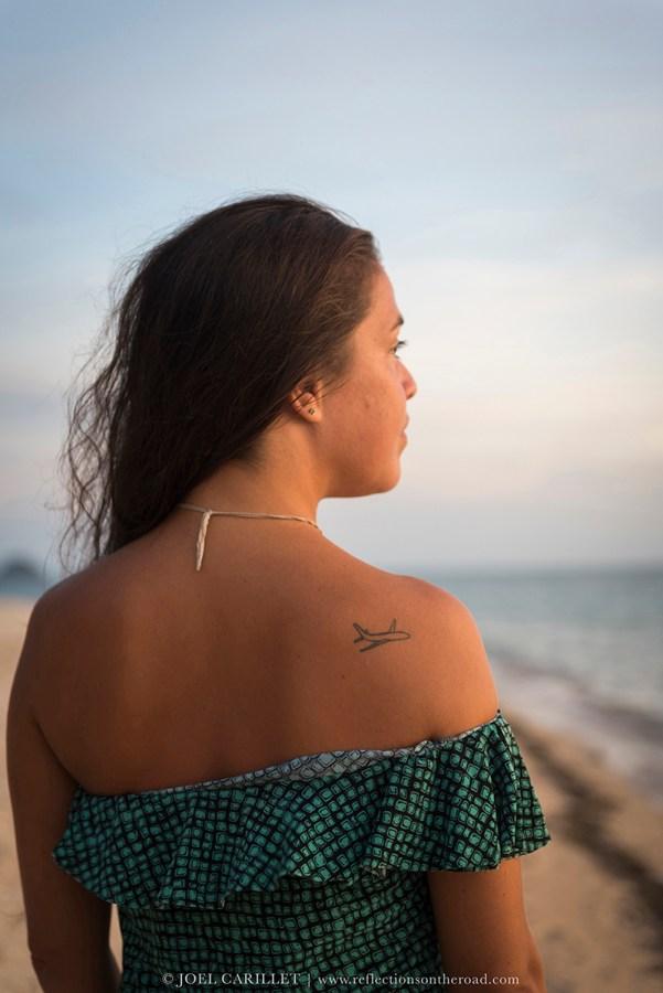 Airplane tattoo on shoulder in Thailand