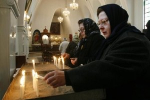 iranian-christian-women-light-candles-during-christmas-mass-at-a