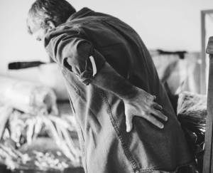 man bent over with low back pain