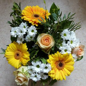 3 Stems of Gerbera flower, 3 Stems of ivory roses with chrysanthemums and filler leaves.