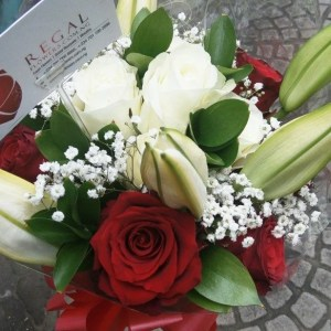 Luxurious mix of red roses, white roses, lilies and gypsophilia (million star) flowers, available in small, medium and large regal