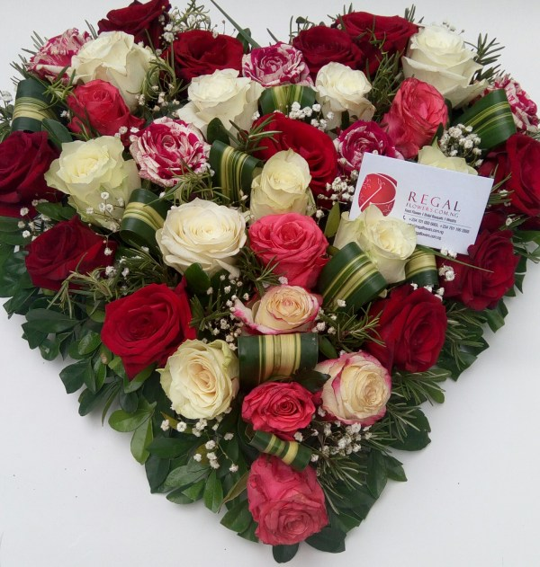 Sweetest Devotion- 3 or 4 colour mix of roses – red, white, fuschial, baby pink etc with folded leaves and filler leaves