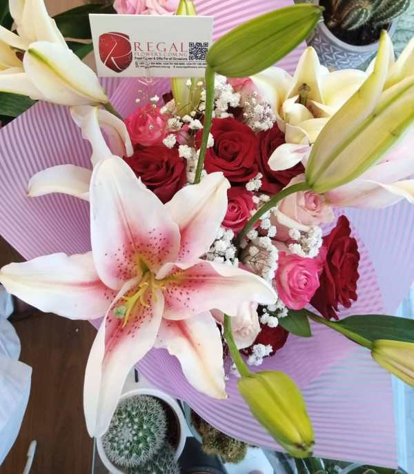 Calligraphy by Regal Fresh Roses, lilies, million stars