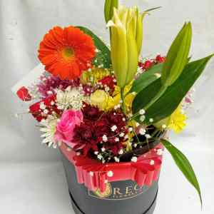 Elegant mix of roses, chrysanthemums, lilies, gerbera and other flowers