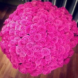 Luxurious giant arrangement of baby or fuchsia pink roses for an impeccable lady