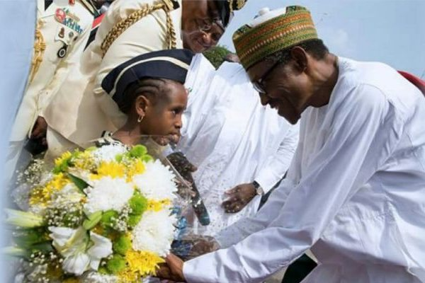 Nigerian President Muhammed Buhari being presented with our flowers by the Nigerian Navy