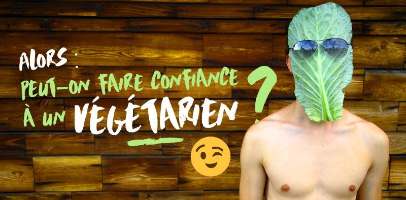 Photo d'un homme à tête de chou devant un mur en planche de bois : Peut-on faire confiance à un végétarien ?