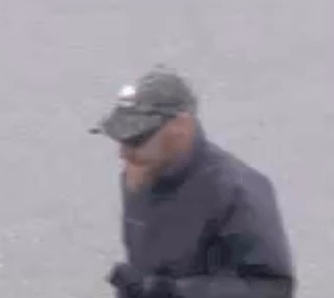 "The Regina Police Service is looking to identify the individual in this series of still images, in relation to a purse-snatching that occurred in a parking lot on the 2100 block of Prince of Wales Drive on on June 13th, 2017, at approximately 7:12 p.m. The suspects is described as a Caucasian male, approximately 5'10"" to 6' tall, with reddish hair, mid-length beard goatee, wearing a camouflage hat, dark windbreaker, tan pants, black gloves, and sunglasses."