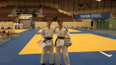 Photo of Twee judoka's met zwarte band