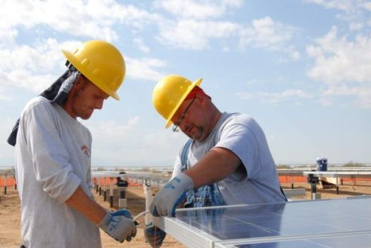 men fixing solar panels
