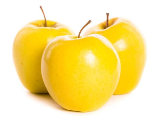 delicious yellow apples on white background