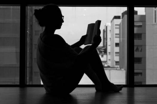 shadow of a woman reading