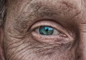 Blue eye of an older man