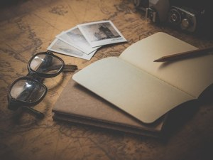 Notebook, reading glasses and pen
