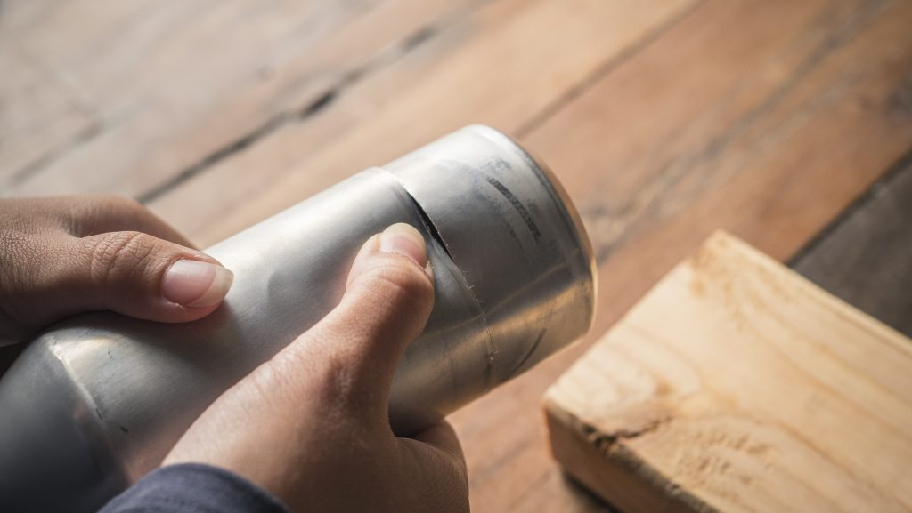 prep the cans for a DIY Alcohol Stove
