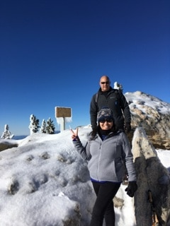 Hazel and her husband hiking in snow.
