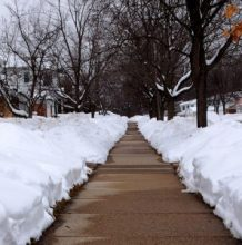 Sidewalk with snowbanks along the sides