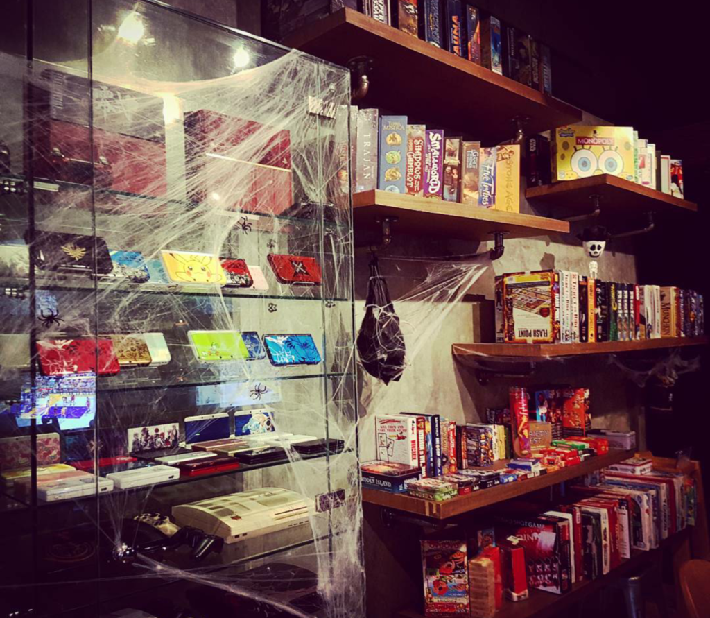 Choose your boardgames (except for the consoles on the glass case, they're more of a museum)