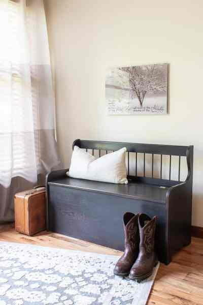solid oak bench painted in Miss Mustard Seed Milk Paint Typewriter with boots and vintage suitcase
