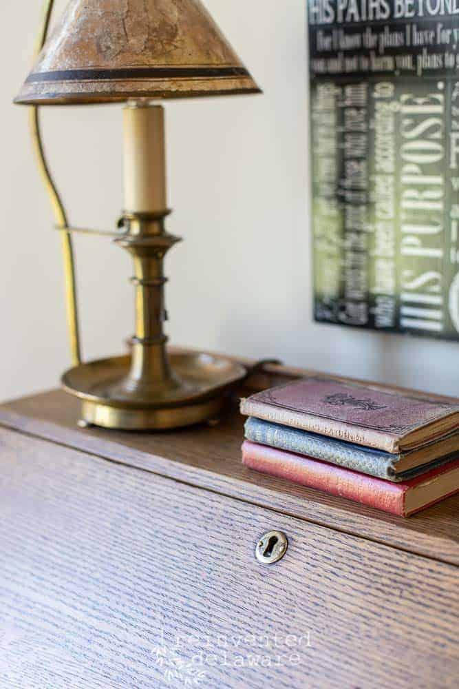keyhole detail on antique oak fold down desk