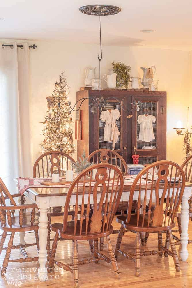 dining room with Christmas tree and large storage cabinet in background