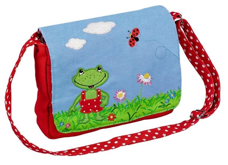 Diese Tasche ist verfügt über eine Extratasche vorne und auch das Innenfutter ist gepunktet. Echt süß...