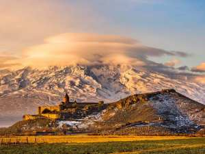 Armenia travel - Armenian church with Aarrat mountain at sunrise