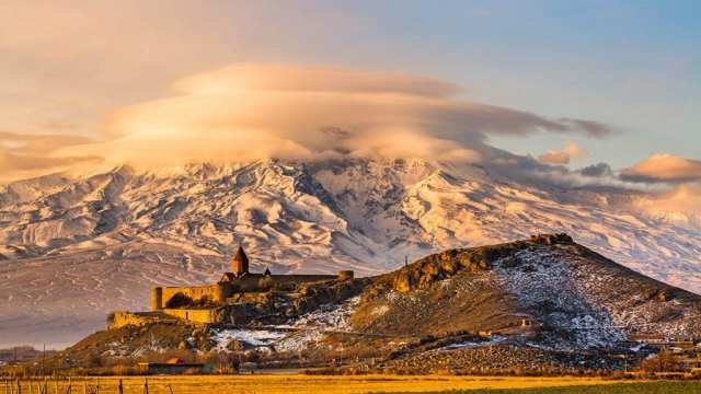 Armenia travel - Armenian church with Aarrat mountain at sunrise