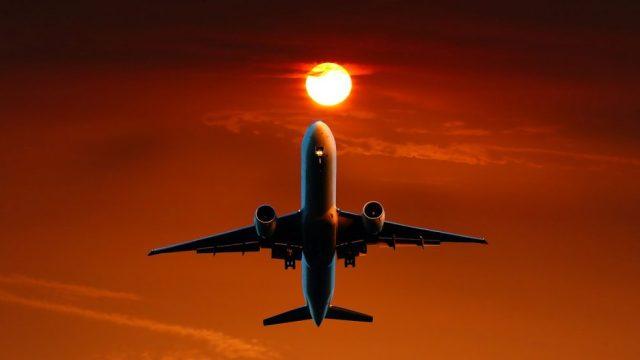 Fly, solnedgang, orange - rejser